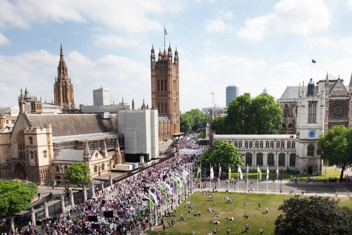 PROCESSIONS crowds in white, violet and green against the backdrop of Westminster in London.