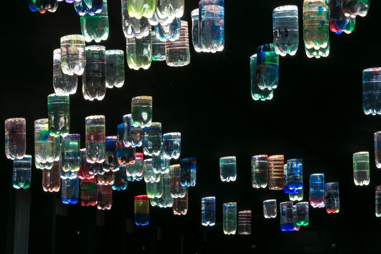 Bottles of water reflecting light with a rainbox