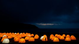Peace Camp at Cliff Beach, Valtos, Isle of Lewis at night, silhouette of a person in front of one of the tents