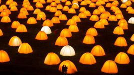 Peace Camp at Dunstanburgh Castle. Two silhouettes of people in front of one of the tents