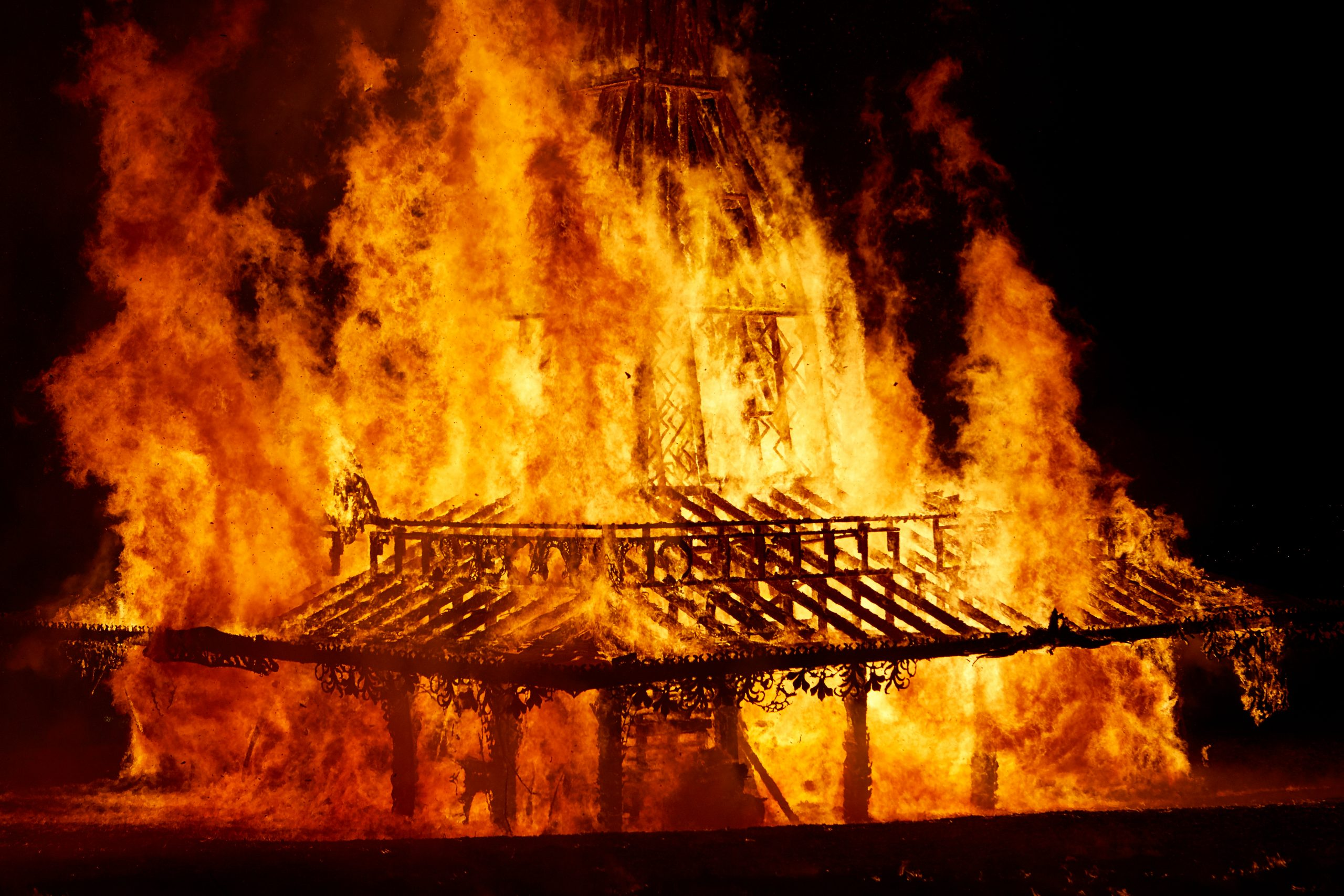 Close up of the Temple structure engulfed in flames