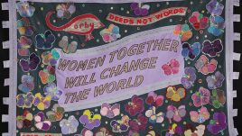 This banner celebrates the individual and collective strength, grace and intelligence of women, especially the women of Corby. The violets were chosen as a symbol of growth, hope and inspiration. Together, the group became a 'creative voice' for women of all ages and backgrounds by sharing their past and present, as well as their hopes and aspirations for the future. 'Deeds Not Words' is also the town motto of Corby, so it was important to the group that it was included, especially given its connection to the Suffragette movement.