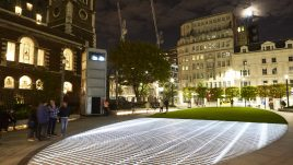 Light installation Hidden Voices: PROCESSIONS in the City at night in Aldgate Square