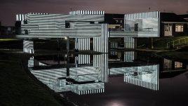 Apollo Pavilion illuminated in striped monochrome light.