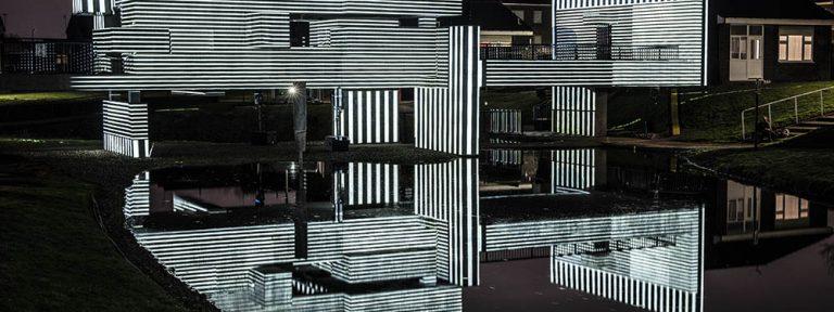 Geometric structure illuminated in monochrome light.