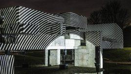 Apollo Pavilion illuminated in striped circular monochrome light