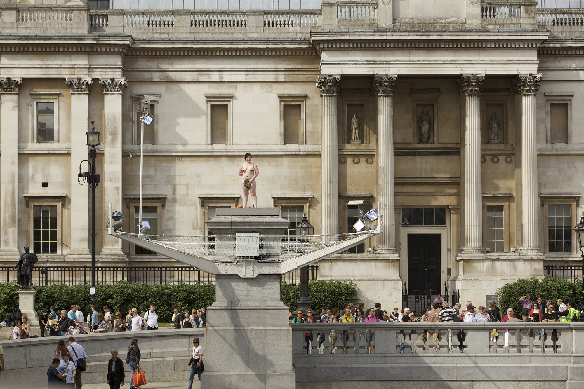 Naked woman standing atop the Fourth Plinth
