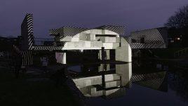 Geometric structure illuminated monochrome patterns.