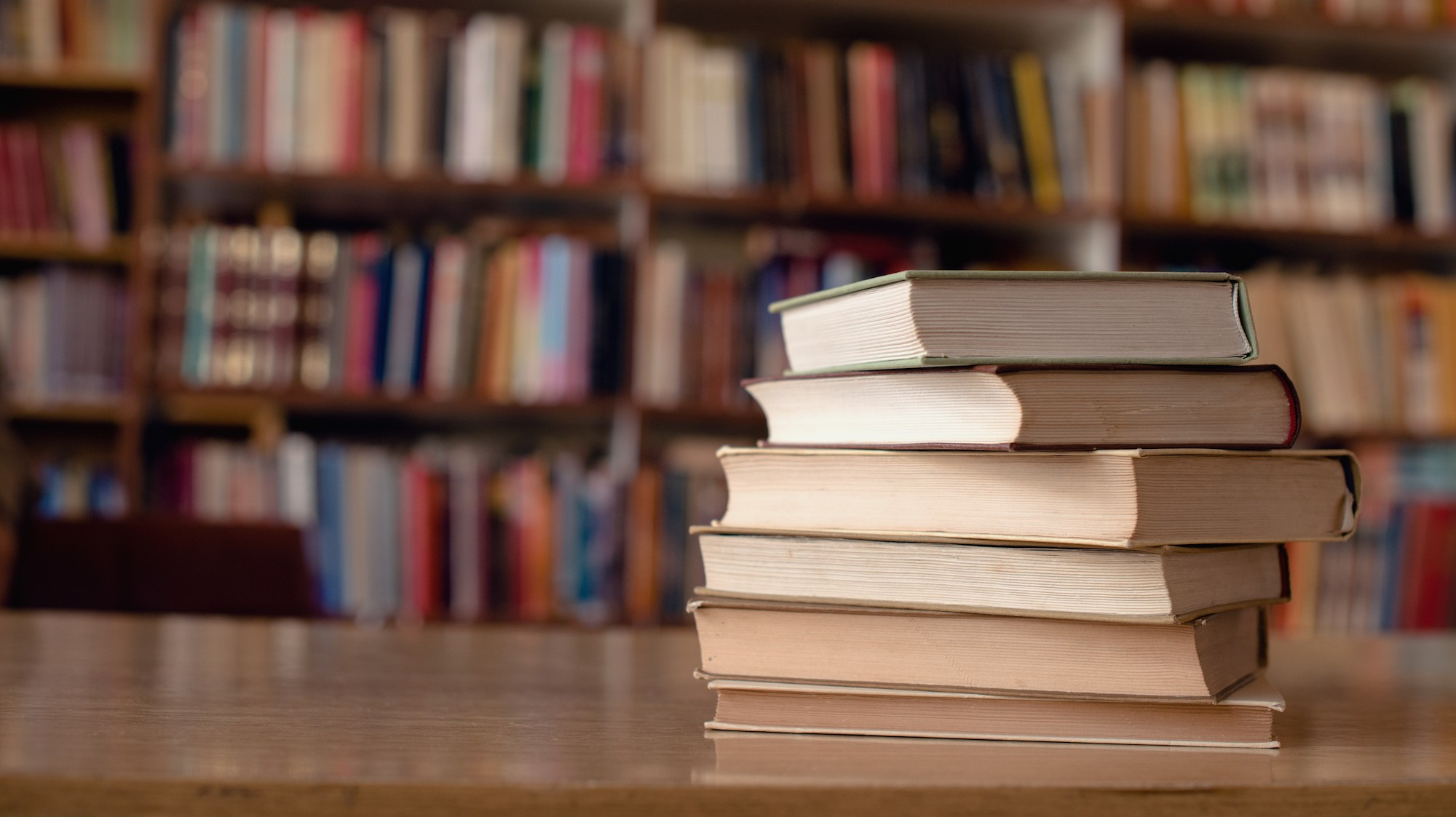 Stack of books on a table.
