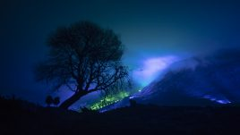 An emerald and blue light roof over the Connemara mountains valley
