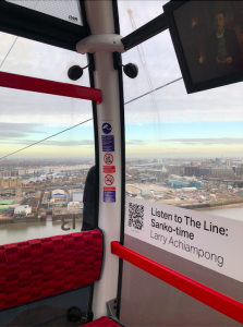 Image of the corner of the Emirates Skyline. There is a view of the river and the city and a label in the carriage with a QR code, next to it says