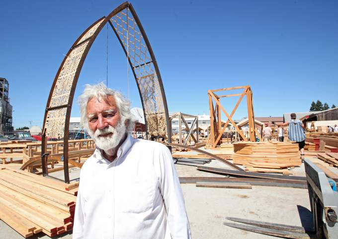 Artist, David Best standing in front of the Temple construction site.