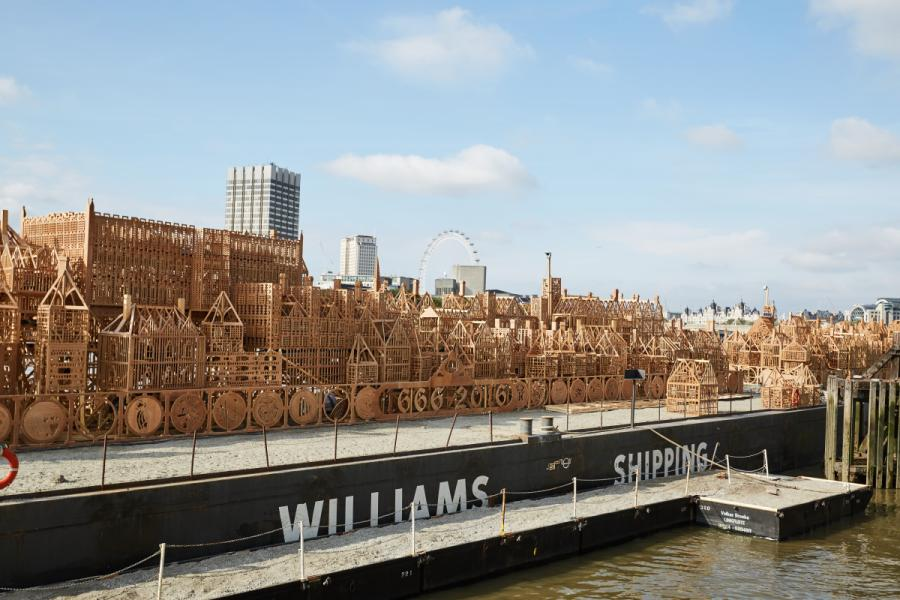Wooden London 1666 structure atop a boat on the River Thames