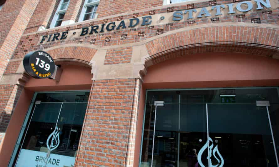 Close-up of the arched doorway of a red brick building- Brigade Bar and Bistro in The Fire Station