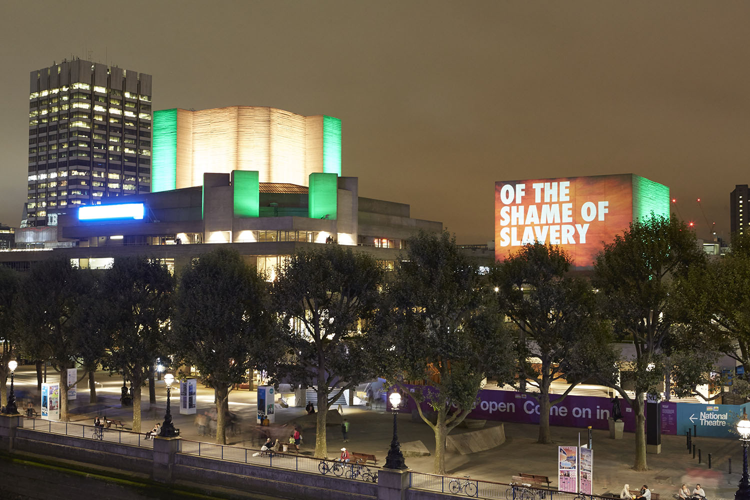 The flytower of the National Theatre in London with the words