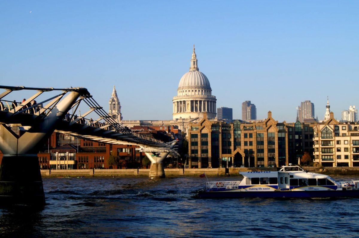 Via of St Paul's Cathedral across the river on a bright day in central London,