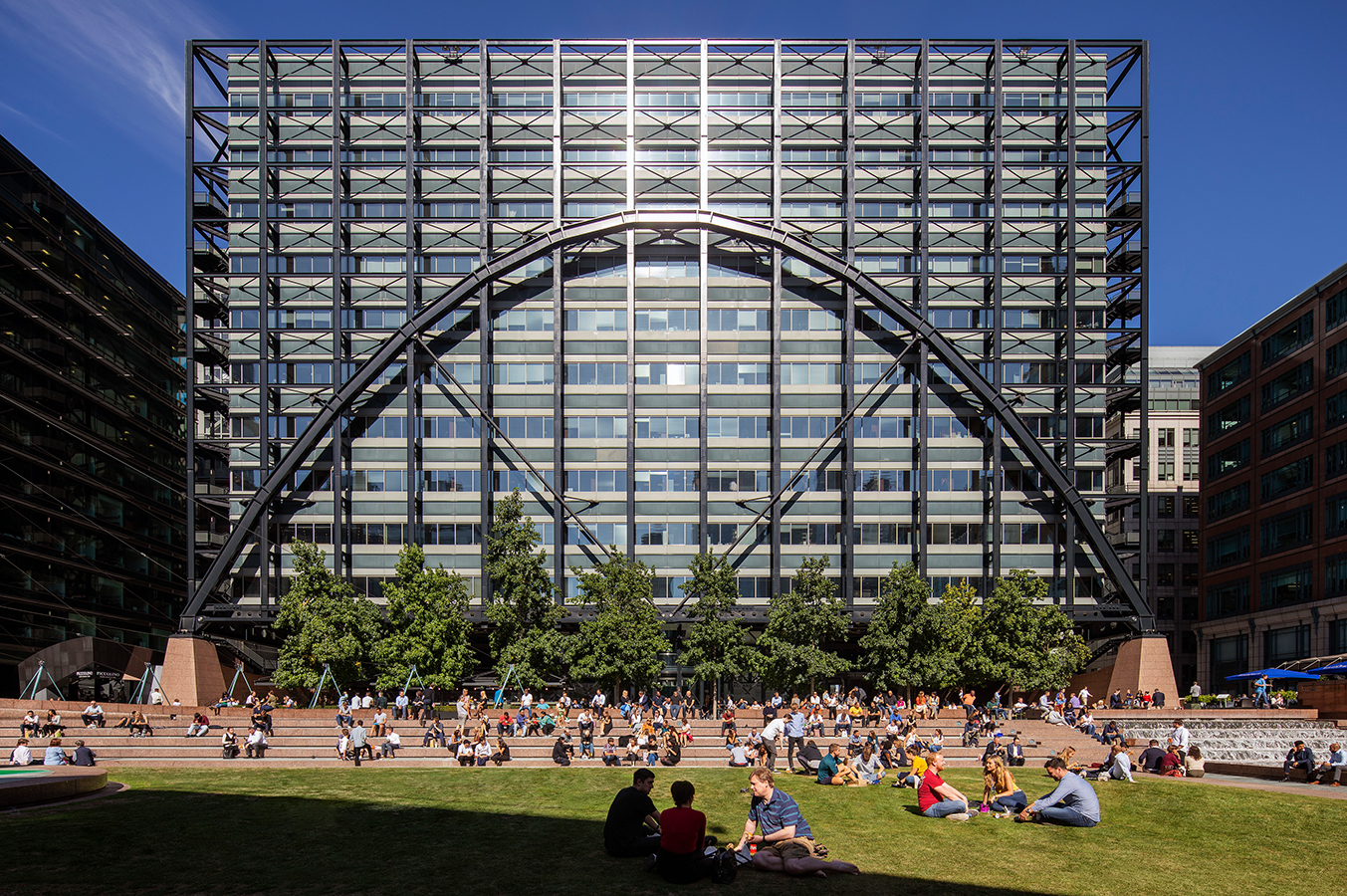 Exchange House, Broadgate. A grassy area in front of a large modern building black