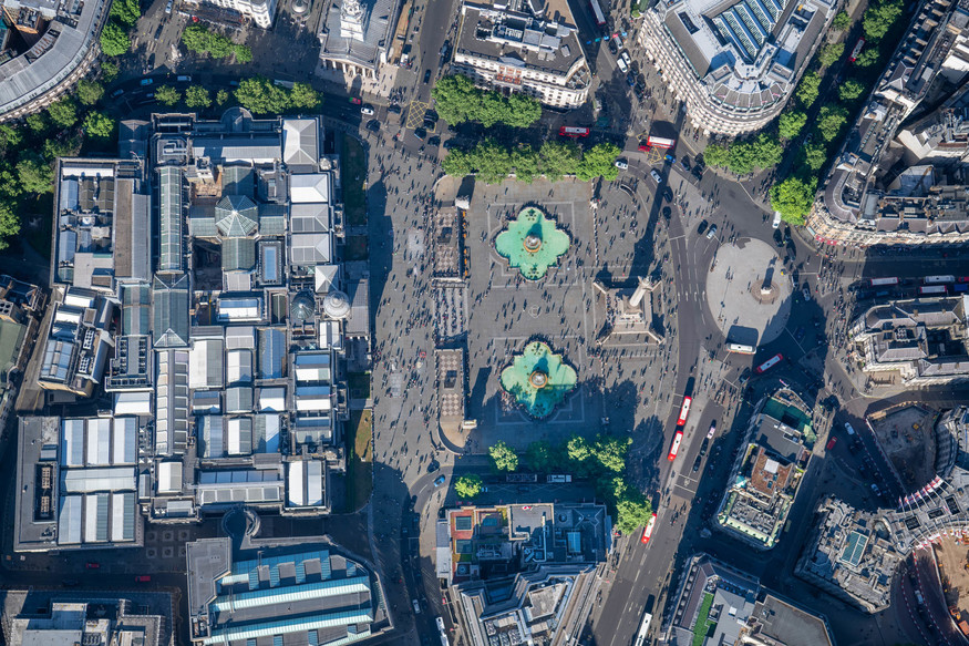 Photo of the streets of London taken from overhead in a helicopter.