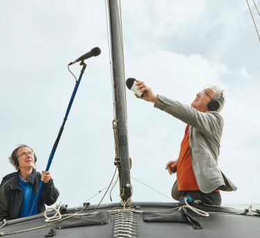 John Del' Nero and Mike Furness recording dinghies.