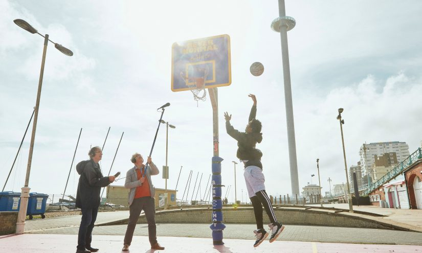 John Del' Nero and assistant recording basketball players on court