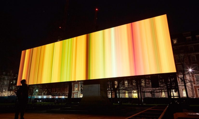 Billboard with warm yellow and red horizontal lines across it
