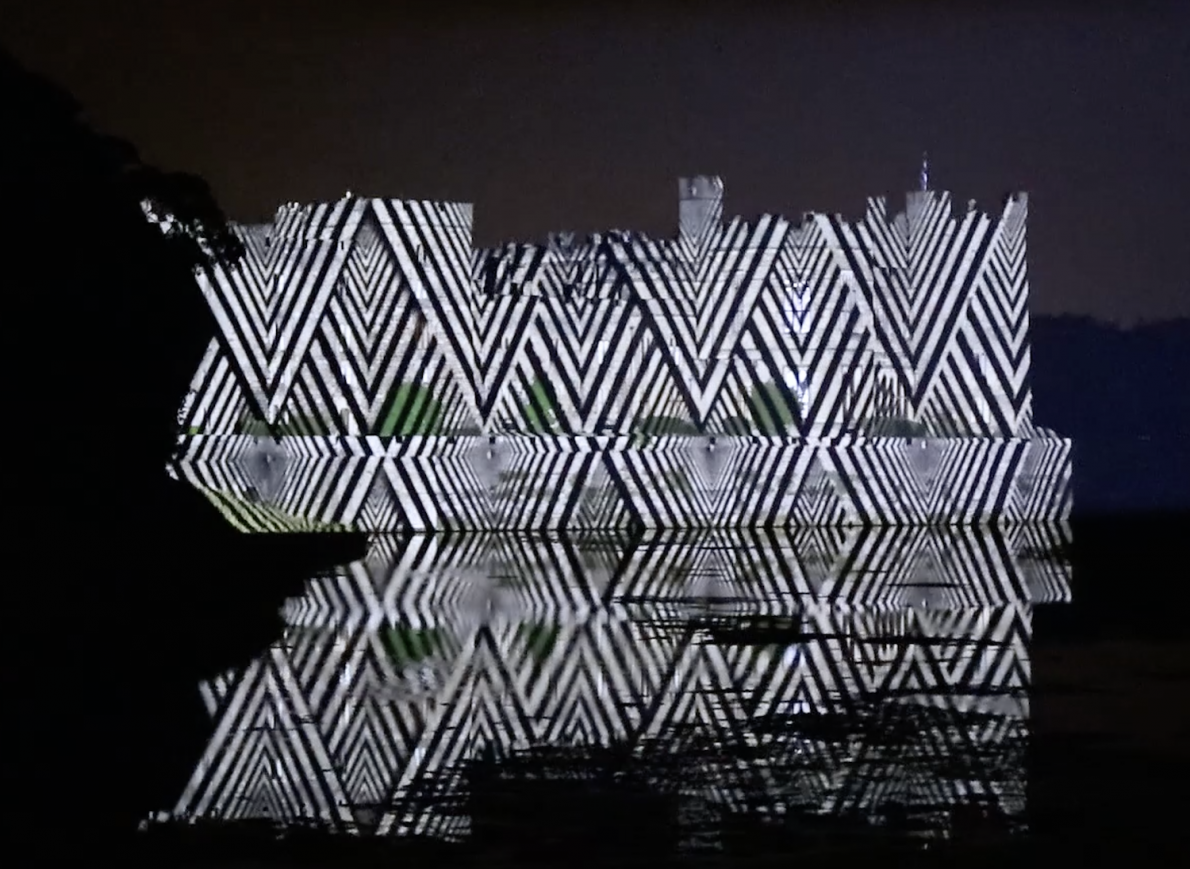 Raby Castle with a black and white zigzag projection over it