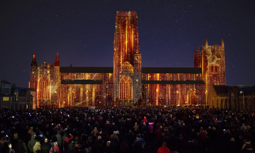Rendering of Durham Cathedral projected with golden rain