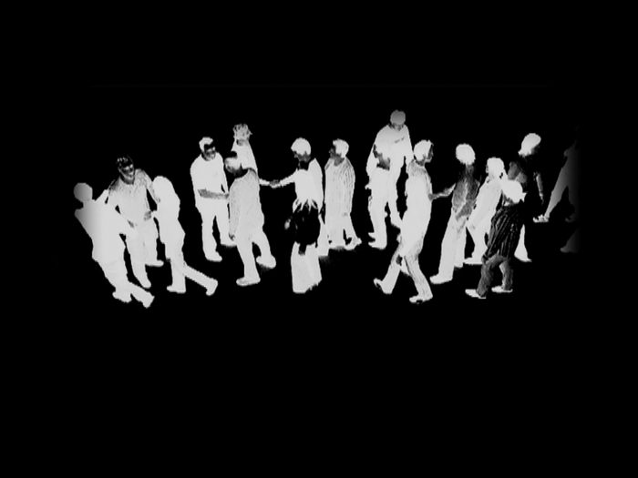 black and white inverted image of crowd of people and shaking hands when they meet in the middle